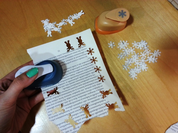Cut small triangles to make abstract Christmas trees from the book pages (as we did for the greeting cards). You can also use punchers to make cute snowflakes or reindeers.